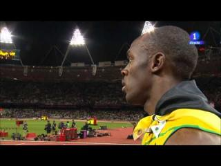 Usain Bolt stopped the interview to hear the U.S. anthem