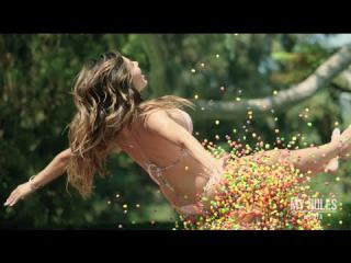 Playmate of the month 2015 Ana Cheri jumps on trampoline with thousands of skittles. SLOW MOTION!